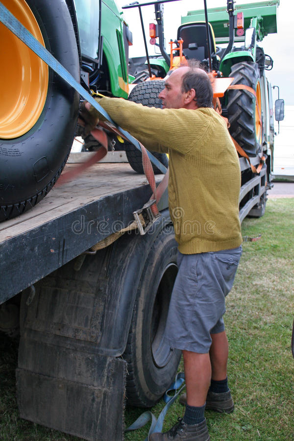 Man loading tractor stock image
