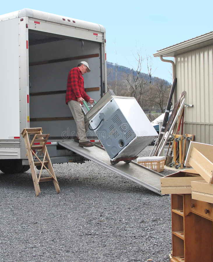 Download Man loads moving van stock photo. Image of relocation - 4641580