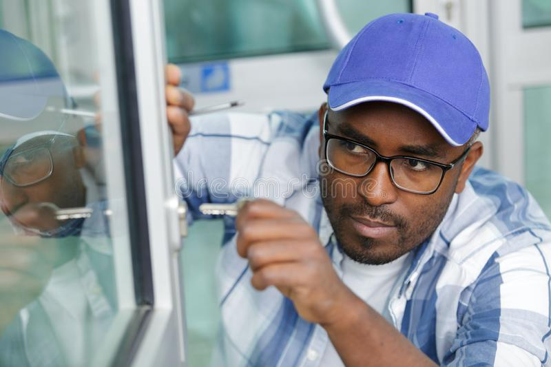 Man locking or opening double glazing window. Man locking or opening a double glazing window royalty free stock image