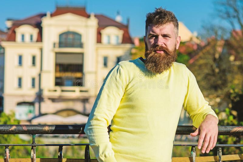 Man with long beard enjoy view from balcony. Relaxation concept. Bearded man have rest on sunny day outdoors. Man with. Beard and mustache on calm face at royalty free stock images