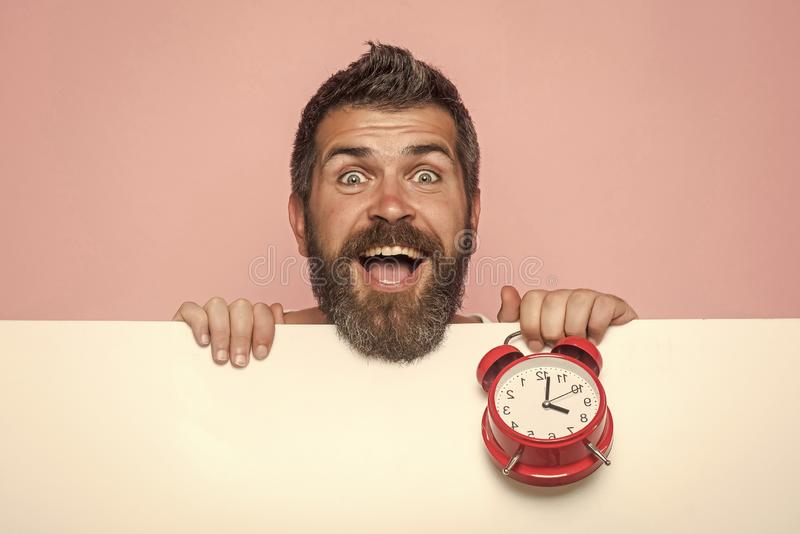 Man with long beard hold alarm clock. stock images
