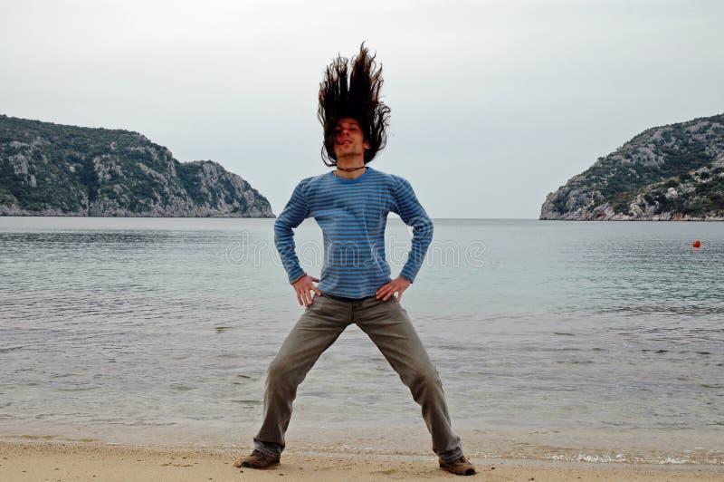 Man with long hair on the beach