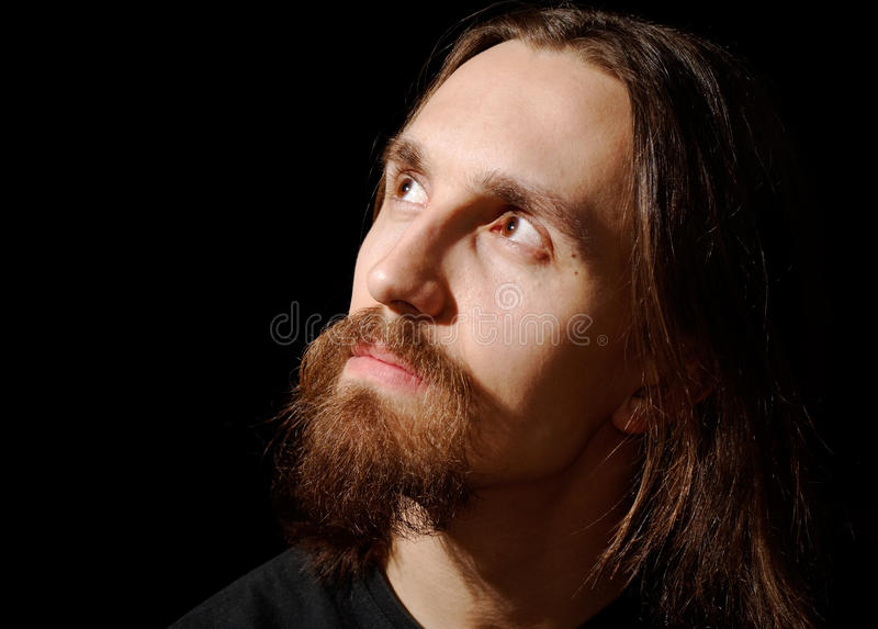 Man With Long Hair And Beard Looking Up And Left Royalty Free Stock Image