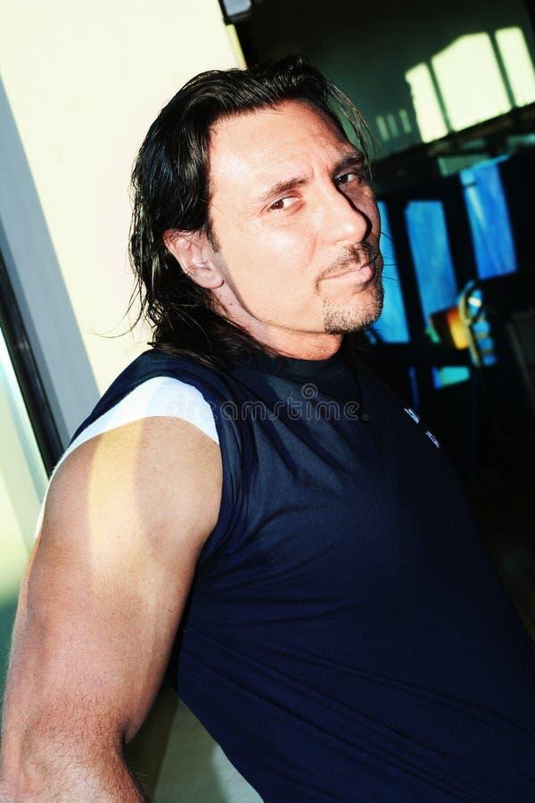 Man long hair looking royalty free stock image