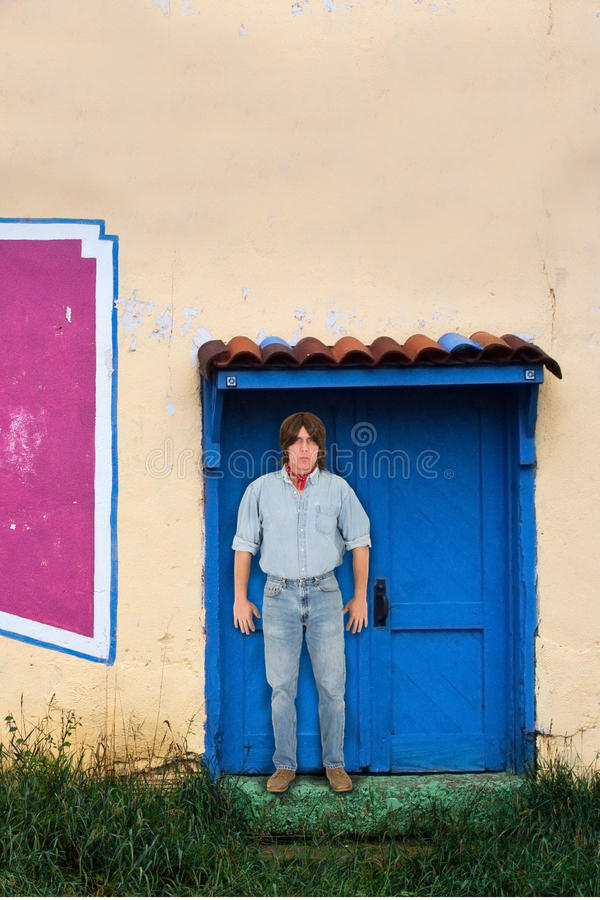 Download Man With Long Hair Standing Adobe Building Doorway Stock Image - Image: 27829249