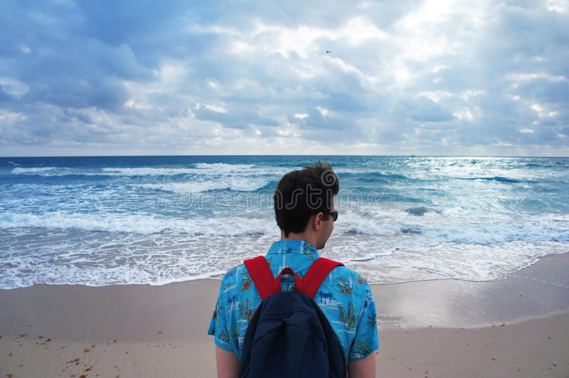 Man look at the Atlantic Ocean in the South Beach of Miami. USA royalty free stock photography