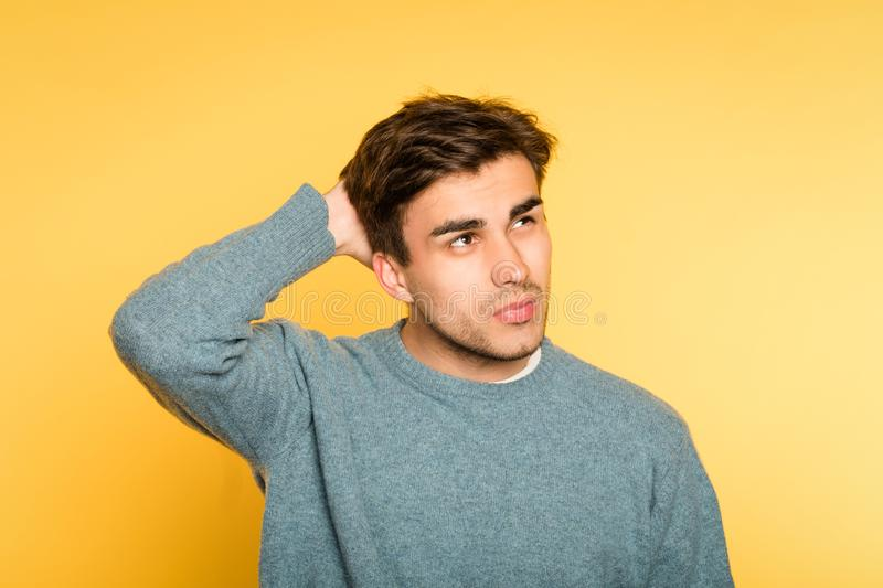 Man look up remember recalling facial expression stock images
