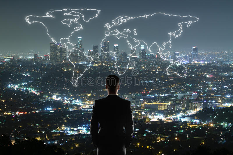 Man looking at abstract map. Travel concept with businessman looking at anstract map on illuminated night city background royalty free stock images