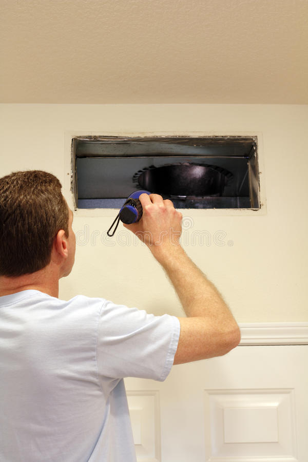 Download Man Looking into Air Duct stock image. Image of maintenance - 25596423