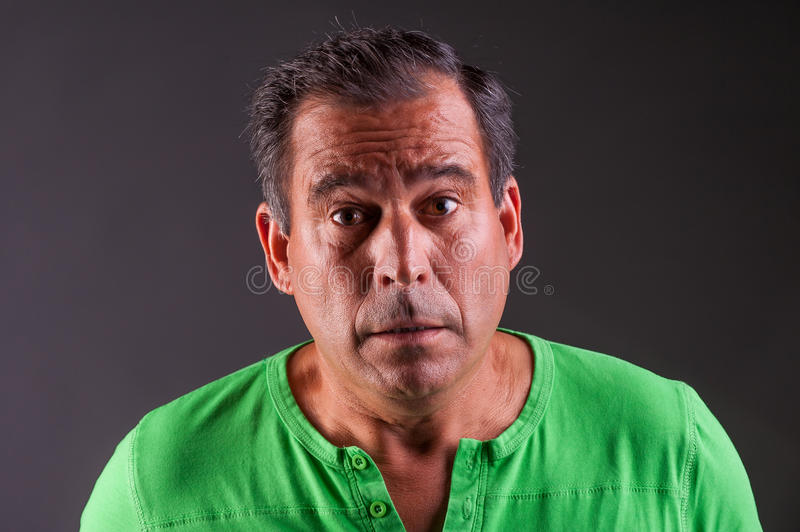 Man looking amazed or confuse. Mature man looking amazed or confuse studio portrait royalty free stock photo