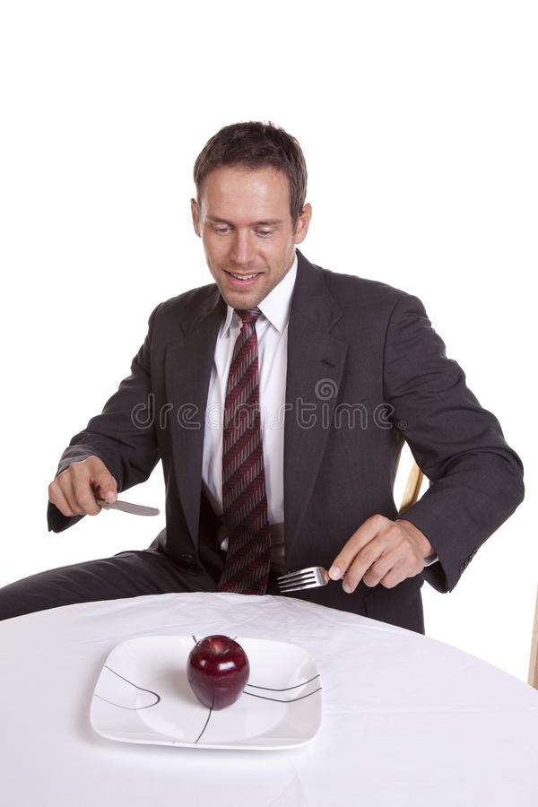 Download Man Looking At Apple On Plate Stock Photo - Image: 16154094