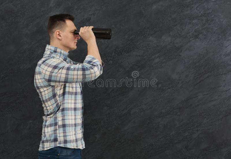 Man looking through beer goggles stock photography