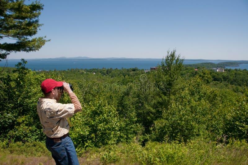 Man Looking Through Binoculars stock images