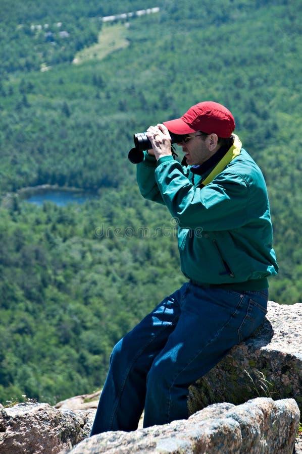 Man Looking Through Binoculars royalty free stock photography