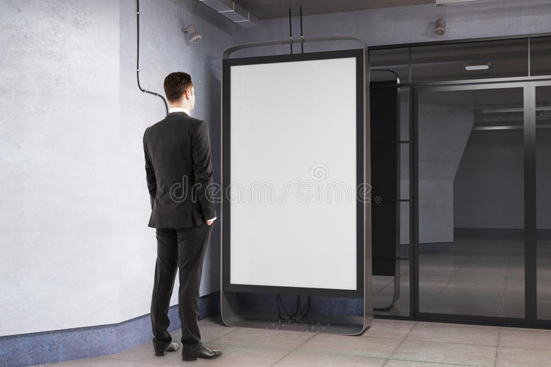 Download Man Looking At Blank Poster Stock Photo   Image Of Metro,  Architecture: 88222312