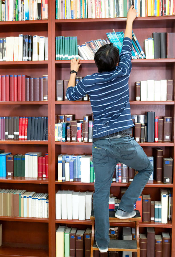 Download Man looking for a book stock photo. Image of latin, books - 25849170