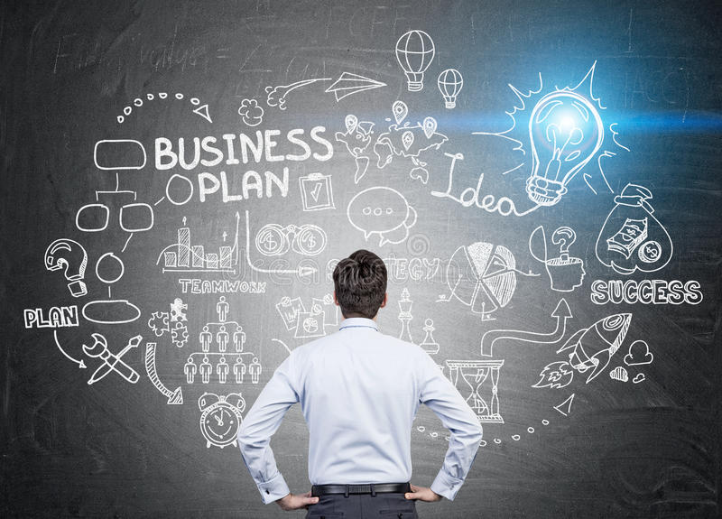 Download Man Looking At Business Plan Sketch Stock Photo - Image: 83722796