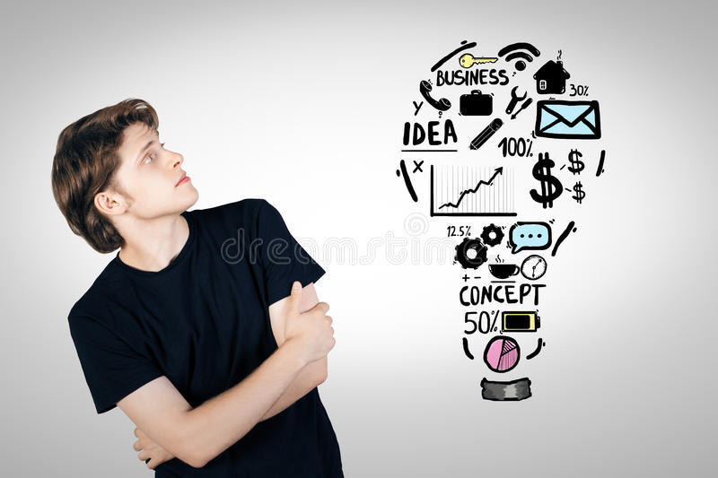Man looking at business sketch royalty free stock photo