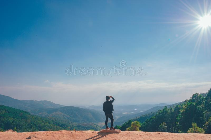 Man Looking on the Cliff royalty free stock photo