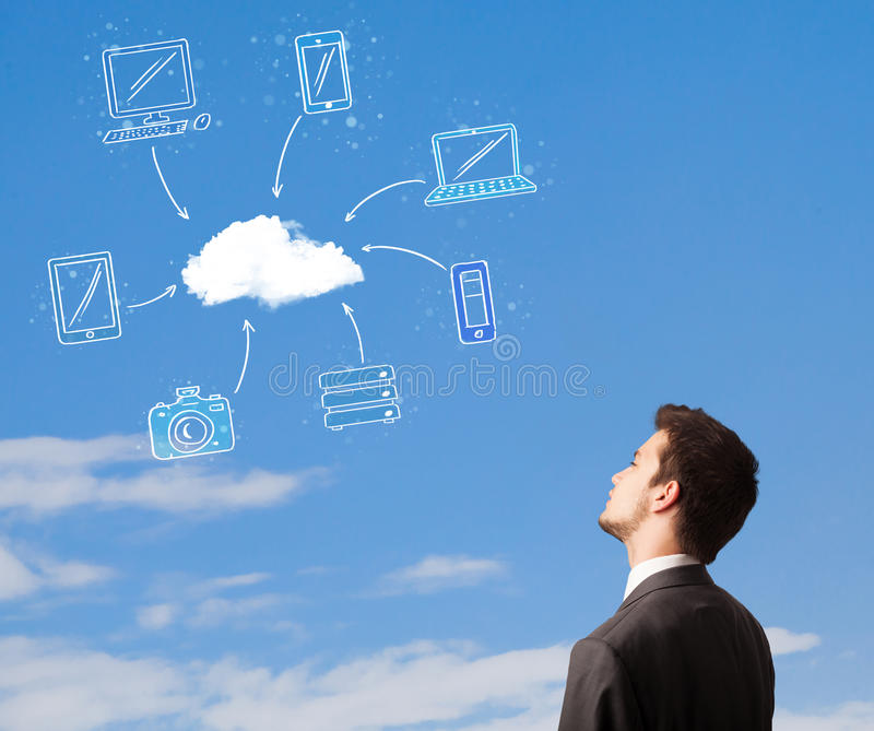 Man looking at cloud computing concept on blue sky. Handsome man looking at cloud computing concept on blue sky stock photos