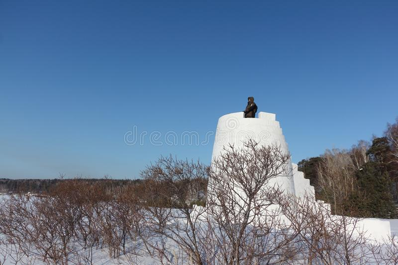 Man looking into the distance from the top of a snow fortress, Siberia, Russia stock photo