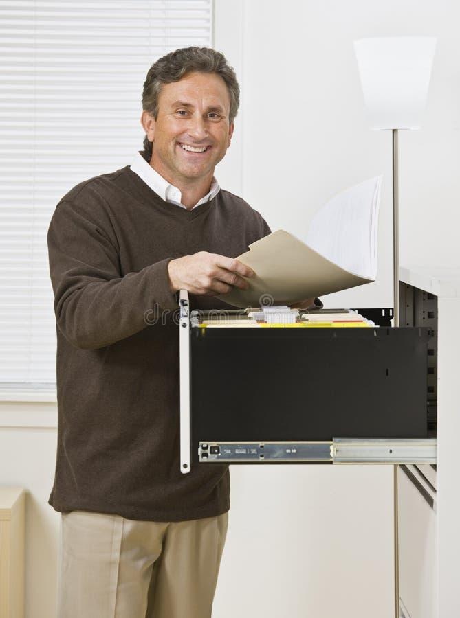 Man Looking Through Files royalty free stock photo