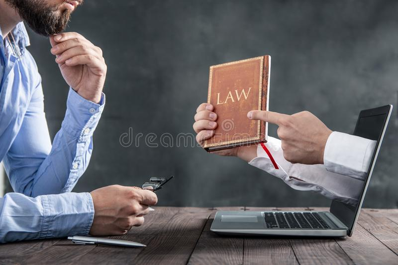 Man is looking at the hands coming out of the laptop royalty free stock photos
