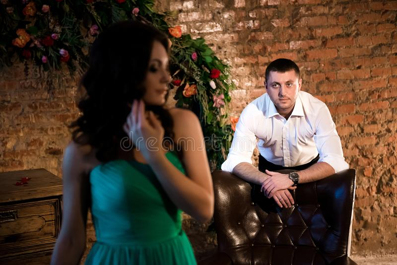 Man looking at her beautiful women standing back to him royalty free stock photography