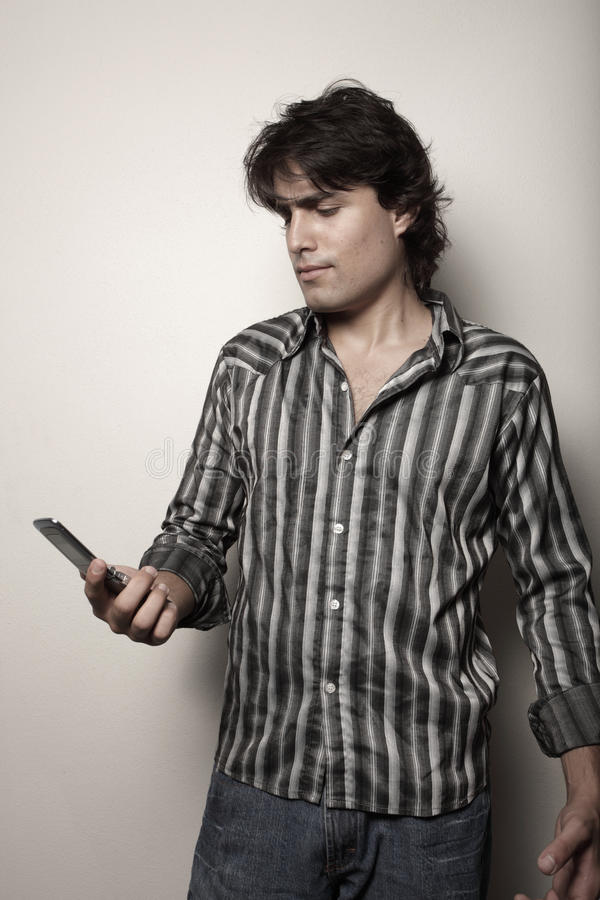 Download Man looking at his phone stock image. Image of young - 10103605
