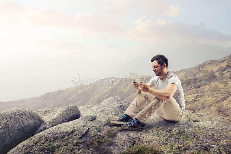 Man looking at his tablet stock image