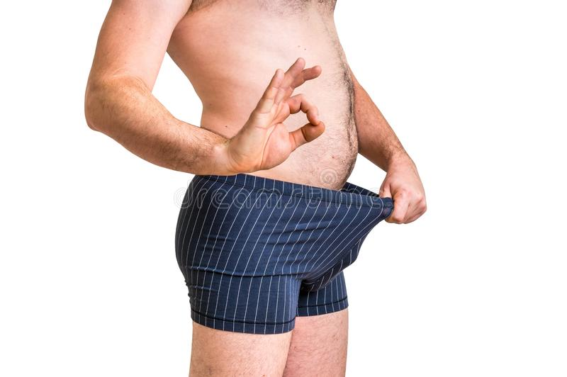 Man is looking in his underwear and pointing OK symbol stock images