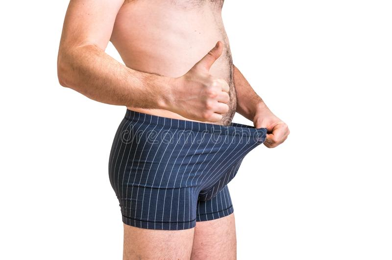 Man is looking in his underwear and pointing thumb up stock images