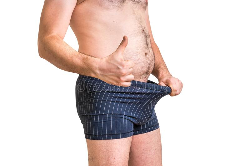 Man is looking in his underwear and pointing thumb up stock photos
