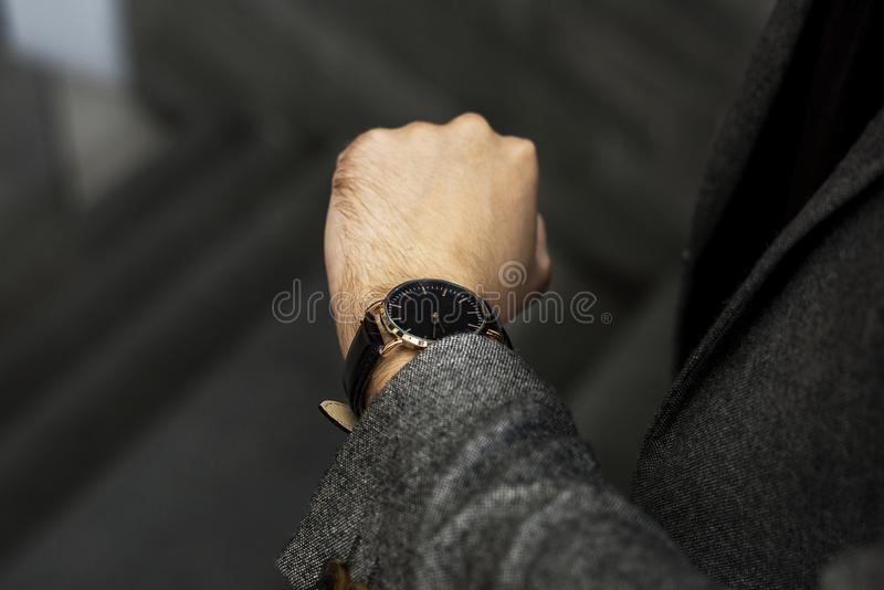 Man looking at his watch stock photography