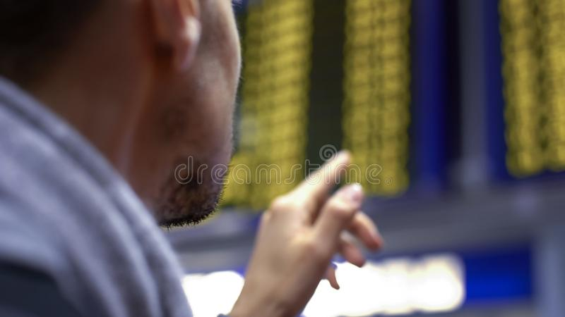 Man looking at information board, choosing meal in fast food restaurant, closeup royalty free stock image