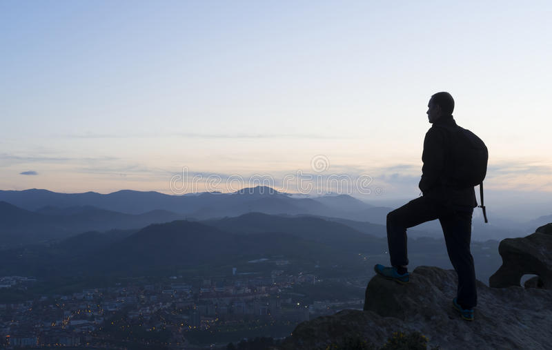 Man looking at the landscape at sunset royalty free stock photos