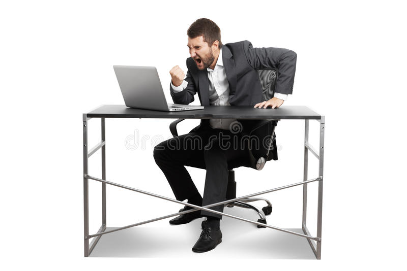 Man looking at laptop and showing fist. Angry businessman looking at laptop, sceraming and showing fist. isolated on white background stock image