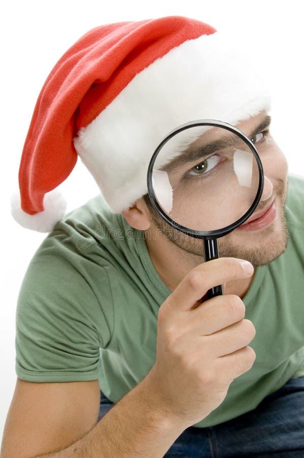Man looking through lens stock image