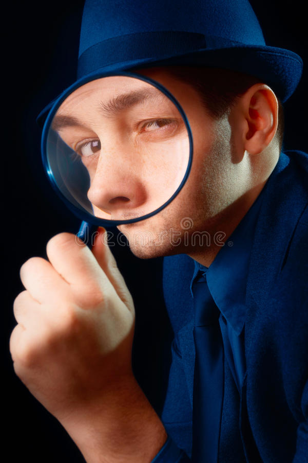 Man Looking through Magnifying Glass royalty free stock image