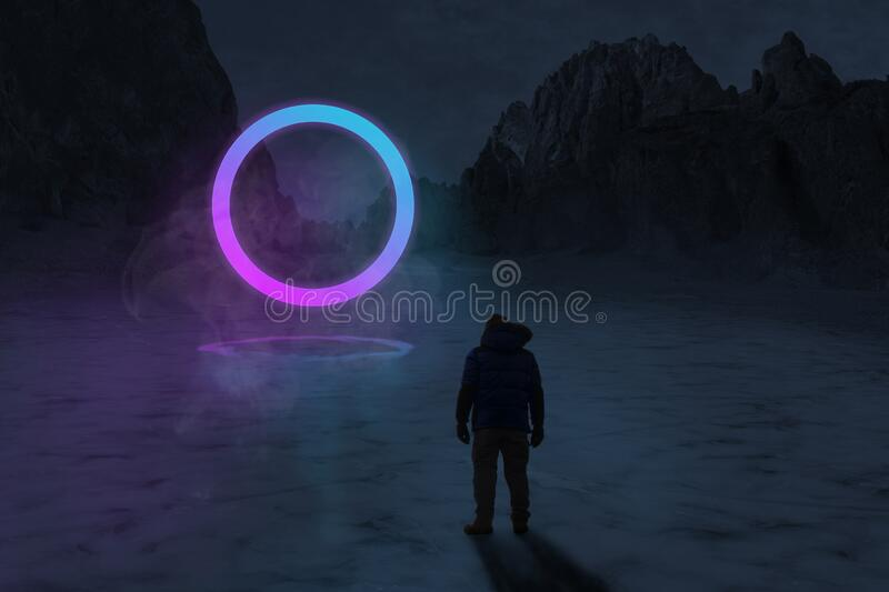 Man looking at neon light of dimensional gate, ice lake at night with mountains in purple and blue tones, futuristic night image. For background, landscape royalty free stock photography