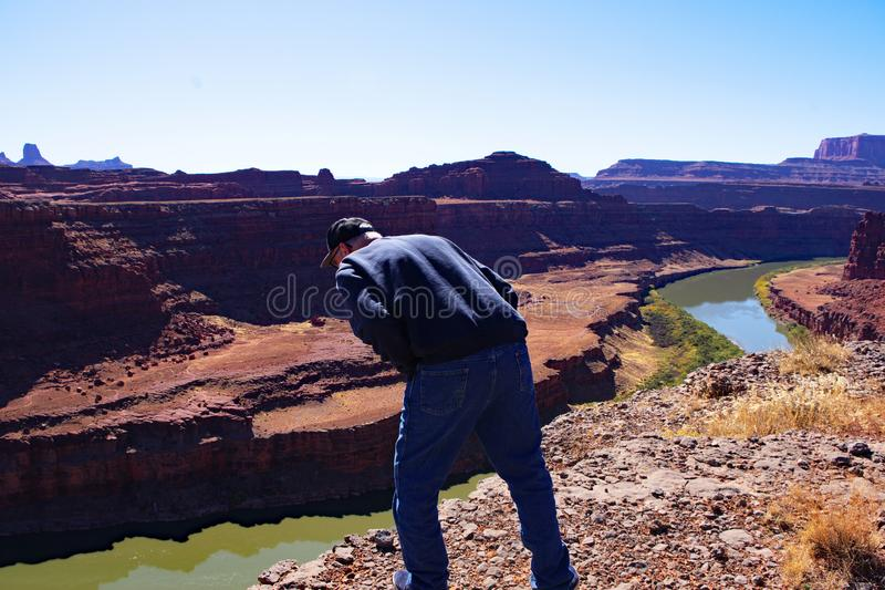 Man Looking Over Cliff Edge stock image