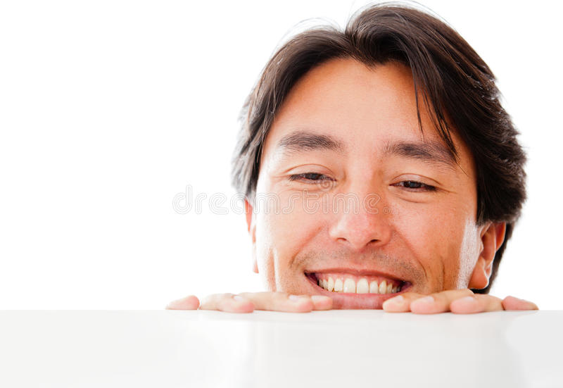 Download Man looking over a table stock photo. Image of looking - 24303096