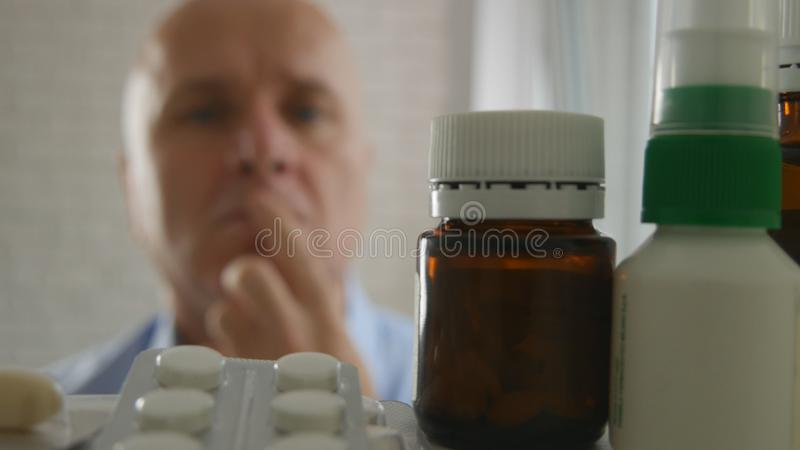 Man Looking for Pills in a Pharmacy Closet. Image with a Man Looking for Pills in a Pharmacy Closet royalty free stock photography