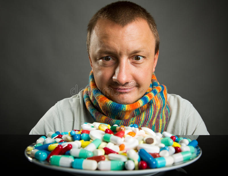 Download Man Looking On Plate Full Of Pills Stock Photo - Image of illness, plate: 26560062