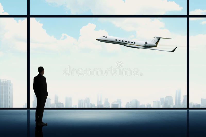 Man looking on the private jet. Business career conceptual royalty free stock photos