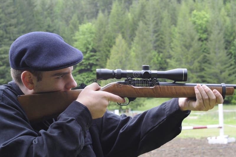 Man looking through scope on stock photos