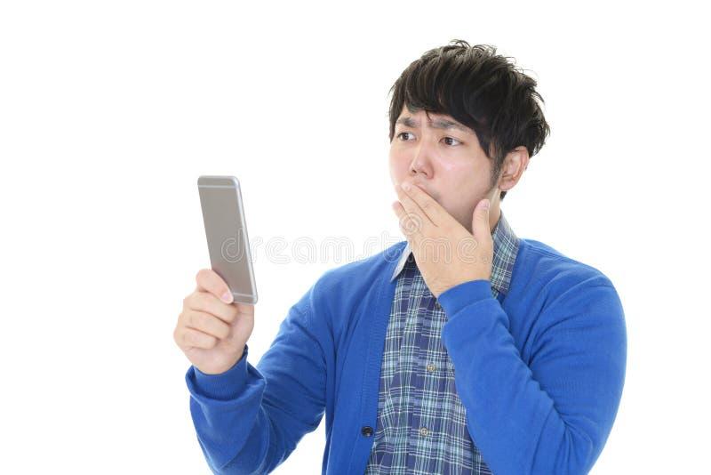 Surprised Asian man stock image
