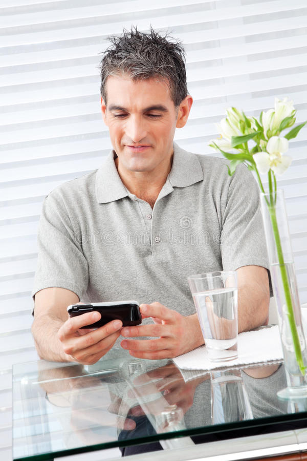 Download Man looking at smartphone stock image. Image of caucasian - 22964947