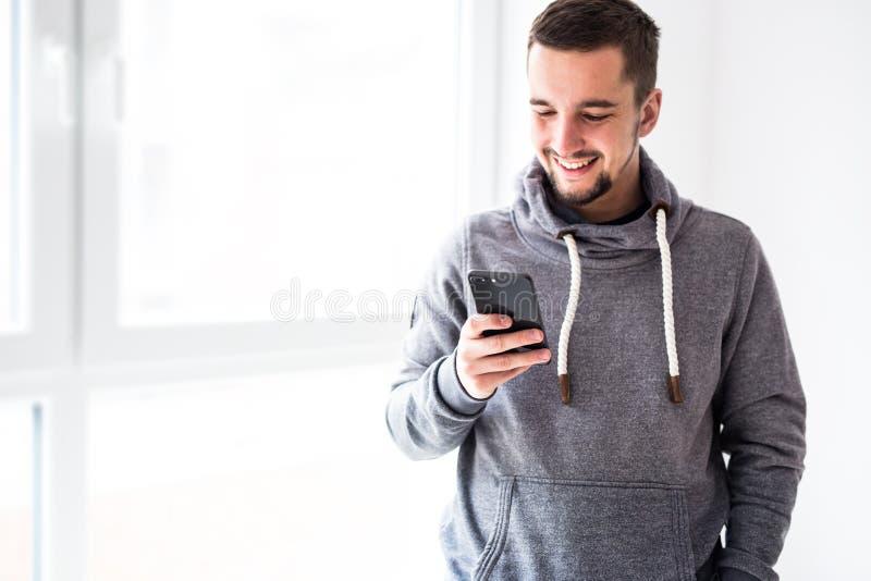 Man using smartphone in home interior stock photo