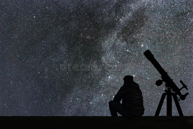 Man looking at the stars, astronomy telescope. Milky Way starry stock image